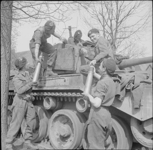 Loading_ammunition_into_Comet_tank_1945_IWM_BU_3617